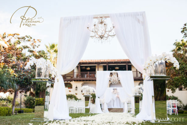 all-white-ceremony-hanging-chandeliers